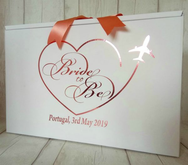 a bride travel box in plane heart